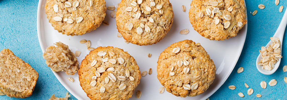 Plate of banana muffins topped with oats