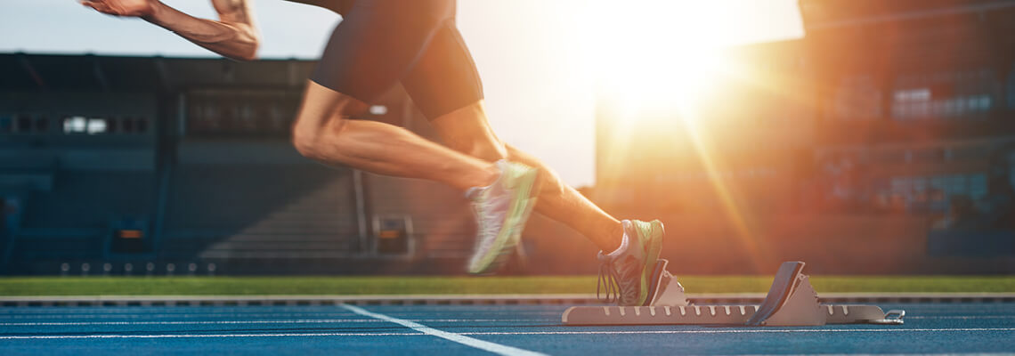 Athlete setting of from starting blocks on a running track