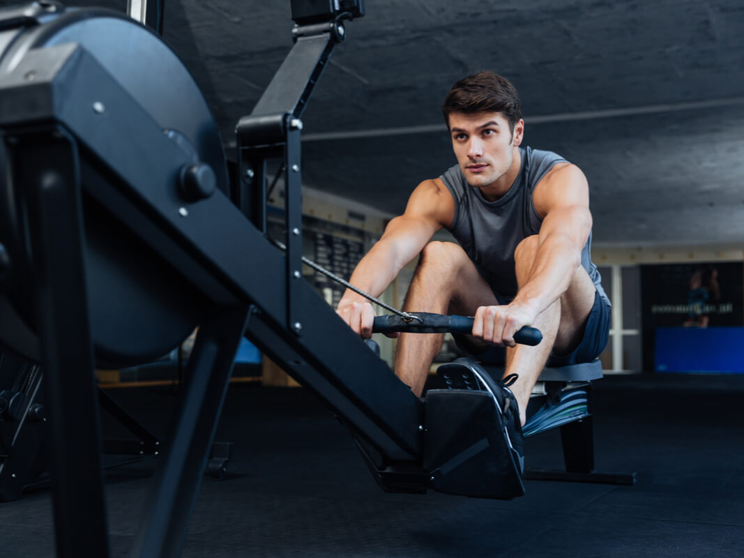man working out on rowing machine