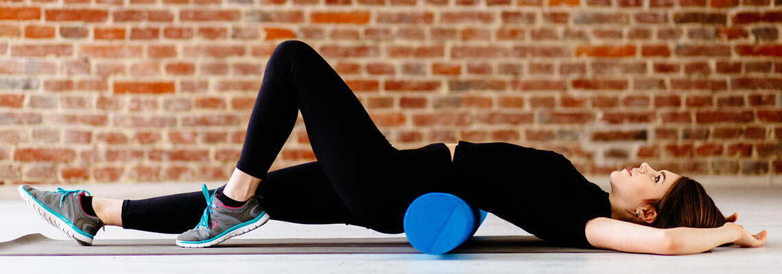 A woman working out with a foam roller